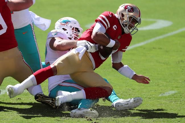 Garoppolo back at practice but needs better O-line play