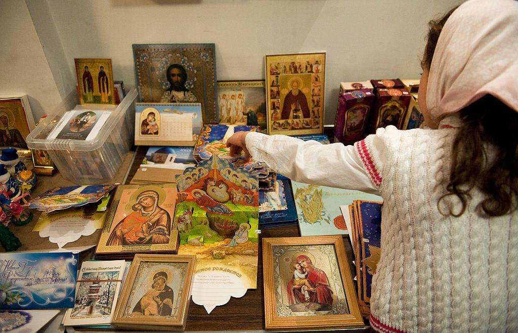 LONDON, ENGLAND: A girl looks at Christmas cards at the London Russian Orthodox Cathedral of the Dormition of the Most Holy Mother of God and Holy Royal Martyrs in London, England. File photo: 2010