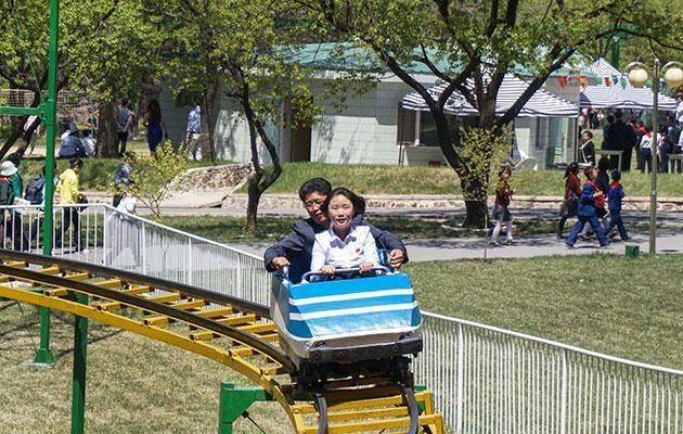 The traveller enjoyed playing archery and rode the old rollercoaster. Photo: Caters News