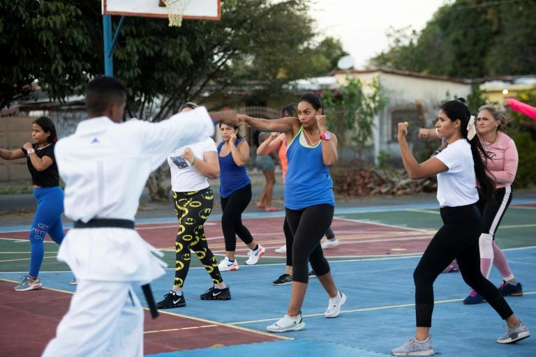 Women and children have been taking self-defense classes in Acarigua, Venezuela, since the murder of two young women in the region