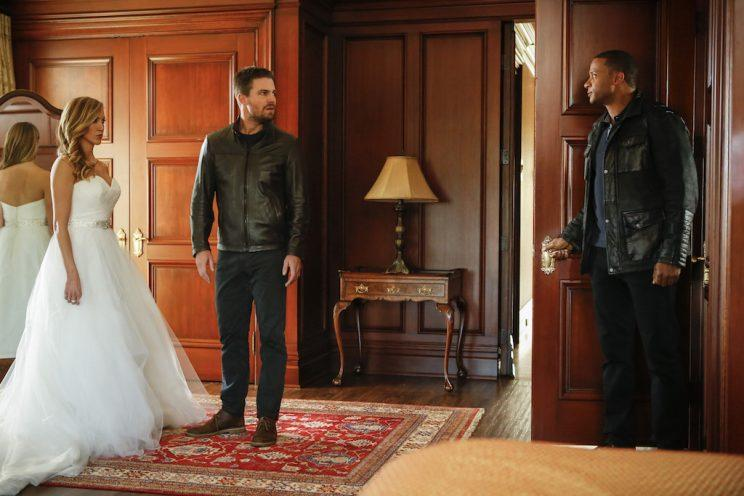 Katie Cassidy as Laurel Lance, Stephen Amell as Oliver Queen, and David Ramsey as John Diggle (Credit: Bettina Strauss/The CW)
