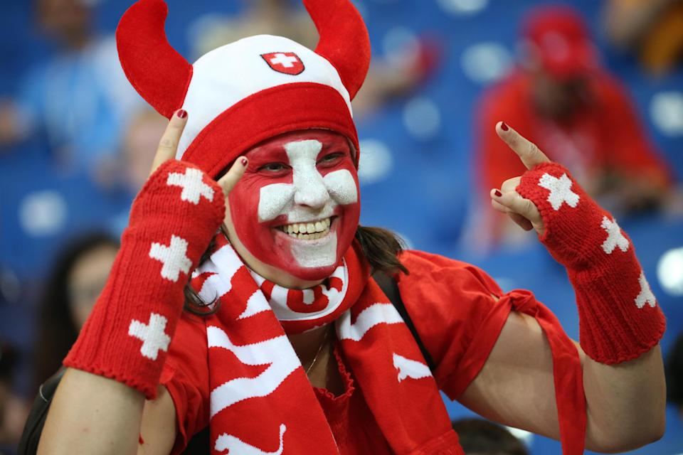 <p>Swiss Miss: A female Switzerland fan decked out all in red. (Getty) </p>