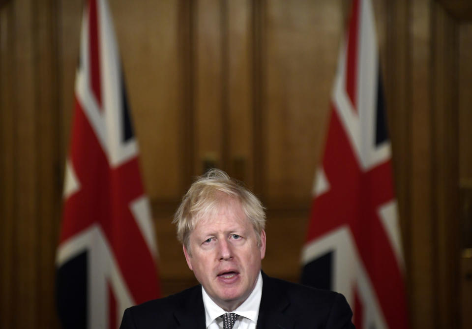 Britain's Prime Minister Boris Johnson speaks during a press conference in 10 Downing Street, London, Saturday, Oct. 31, 2020 where he announced new restrictions to help combat a coronavirus surge. (AP Photo/Alberto Pezzali, Pool)