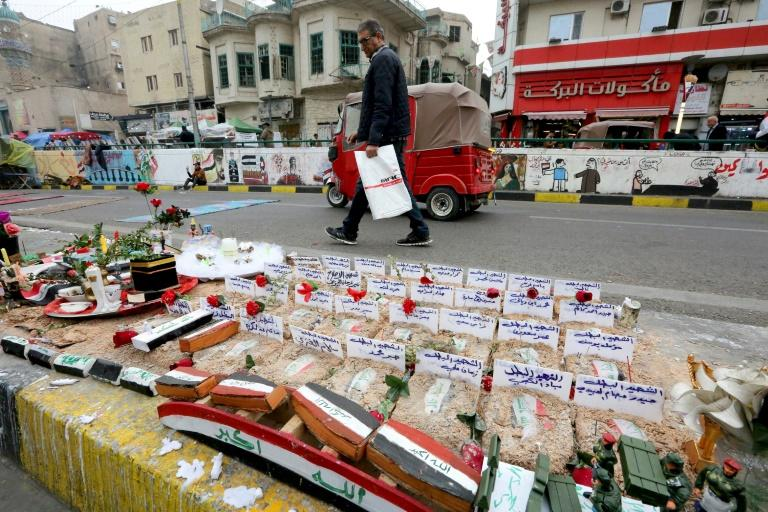 Iraqi protesters set up an installation in Bahdad's Tahrir Square to honour fallen comrades
