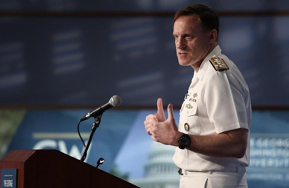 US Admiral Michael Rogers, who heads the National Security Agency and US Cyber Command, has said that future attacks could prompt a response with conventional weapons (AFP Photo/Win Mcnamee)