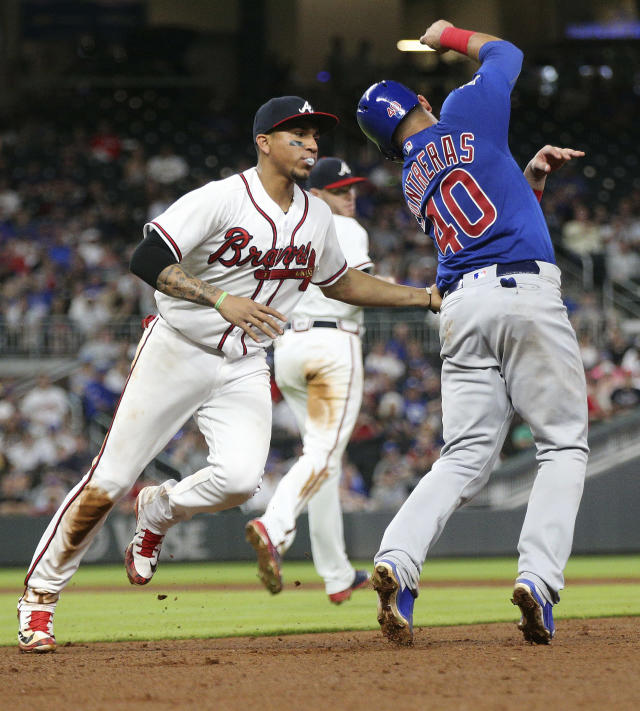 Atlanta Braves' Johan Camargo tags Chicago Cubs Willson Contreras out in a rundown between first and second during the sixth inning of a baseball game Wednesday, May 16, 2018, in Atlanta. (Curtis Compton/Atlanta Journal-Constitution via AP)