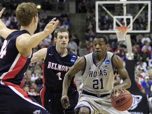 Georgetown's Jason Clark (21) drives past Belmont's Mick Hedgepeth (34) and Drew Hanlen (1) during the first half of an NCAA men's college basketball tournament second-round game in Columbus, Ohio, Friday, March 16, 2012. Georgetown won 74-59. (AP Photo/Tony Dejak)