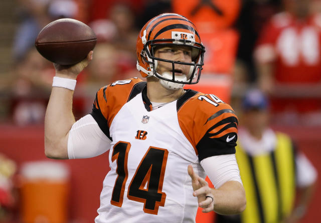 Cincinnati Bengals quarterback Andy Dalton looks for a receiver in the first half of an NFL preseason football game against the Kansas City Chiefs on Thursday, Aug. 7, 2014, in Kansas City, Mo. (AP Photo/Nati Harnik)