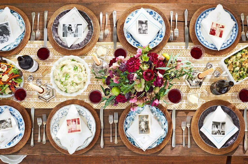 """<p>A gold-patterned table runner, mismatched vintage china, and a vibrant bouquet of seasonal blooms are all this Thanksgiving table needs to stand out. For a personal touch, use family photos in lieu of place cards. </p><p><strong><a class=""""link rapid-noclick-resp"""" href=""""https://go.redirectingat.com?id=74968X1596630&url=https%3A%2F%2Fwww.crateandbarrel.com%2Fartesia-rattan-charger-plate%2Fs441523&sref=https%3A%2F%2Fwww.countryliving.com%2Fentertaining%2Fg2130%2Fthanksgiving-centerpieces%2F"""" rel=""""nofollow noopener"""" target=""""_blank"""" data-ylk=""""slk:SHOP RATTAN CHARGERS"""">SHOP RATTAN CHARGERS</a></strong></p>"""