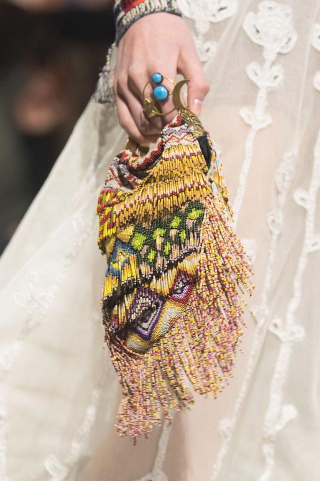 <p>Dior paired a vibrant, intricately beaded mini bag with turquoise rings and lace trim in 2018. </p>
