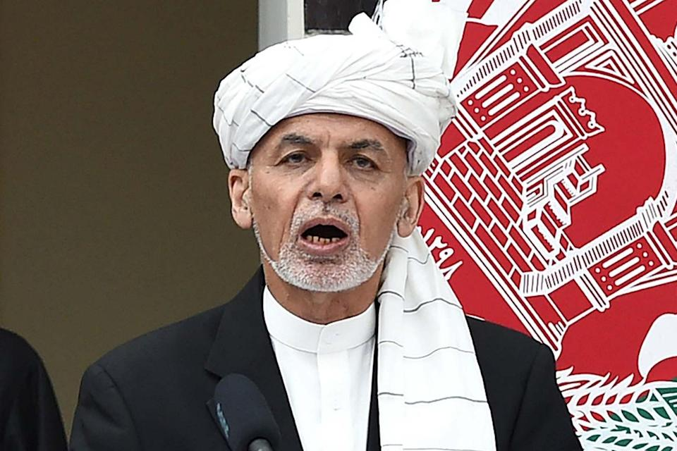 Ashraf Ghani recites the oath during his swearing-in at the inauguration ceremony as the country's leader in March 2020 (AFP via Getty Images)