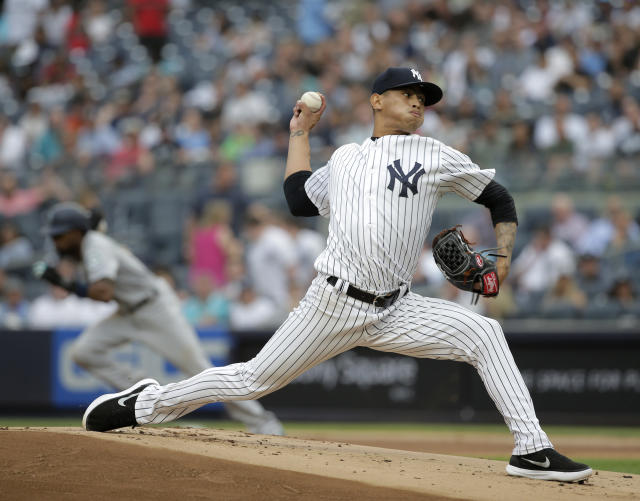 New York Yankees starting pitcher Jonathan Loaisiga throws during the first inning of a baseball game against the Seattle Mariners at Yankee Stadium Wednesday, June 20, 2018, in New York. (AP Photo/Seth Wenig)