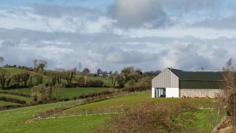 EMBARGOED TO 2200 WEDNESDAY NOVEMBER 13 Undated handout photo issued by Aidan McGrath of House Lessans, a three-bedroom property with white rendered, concrete walls in Co Down, Northern Ireland, which cost ??335,000 to build has been named House of the Year.
