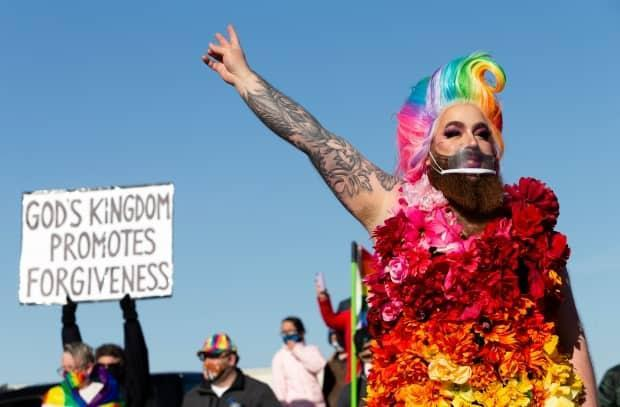 Attendees were given a performance from the drag queen Katy Hairy at Sunday's rally outside Victory Church. (Bryan Eneas/CBC - image credit)