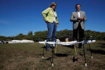 Helen Greiner, founder of CyPhy Works, and John Dodero, UPS vice president of industrial engineering, talk about the CyPhy Works drone which carried a UPS package to Children's Island off the coast of Beverly, Massachusetts. REUTERS/Brian Snyder
