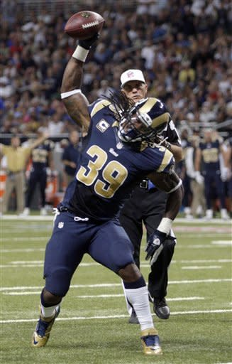 St. Louis Rams running back Steven Jackson spikes the ball after coming up short of the end zone during the second quarter of an NFL football game against the Washington Redskins, Sunday, Sept. 16, 2012, in St. Louis. Jackson was given an unsportsmanlike penalty for the spike. (AP Photo/Tom Gannam)