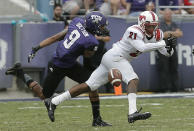 SMU defensive back Kenneth Acker (21) nearly intercepts the pass intended for TCU wide receiver Josh Doctson (9) during the first half of an NCAA college football game Saturday, Sept. 28, 2013, in Fort Worth, Texas. (AP Photo/Brandon Wade)
