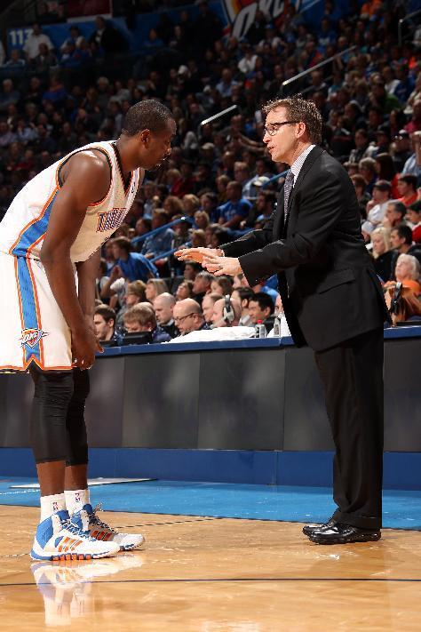 OKLAHOMA CITY, OK - JANUARY 21: Scott Brooks of the Oklahoma City Thunder talks with Serge Ibaka #9 during the game against the Portland Trail Blazers on January 21, 2014 at the Chesapeake Energy Arena in Oklahoma City, Oklahoma. (Photo by Layne Murdoch/NBAE via Getty Images)