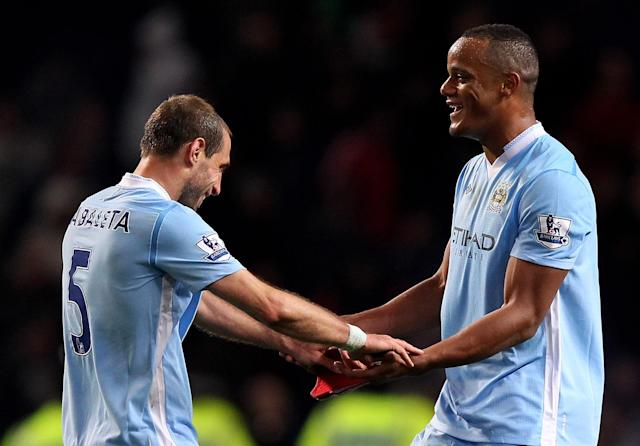 MANCHESTER, ENGLAND - APRIL 30: Vincent Kompany of Manchester City celebrates with team mate Pablo Zabaleta (L) at the end of the Barclays Premier League match between Manchester City and Manchester United at the Etihad Stadium on April 30, 2012 in Manchester, England. (Photo by Alex Livesey/Getty Images)