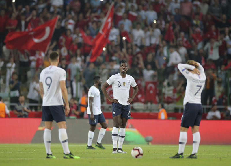 France's forward Olivier Giroud, left, Paul Pogba, center, and France's forward Antoine Griezmann prepare to kick-off after Turkey scored a goal during the Euro 2020 Group H qualifying soccer match between Turkey and France in Konya, Turkey, Saturday June 8, 2019. (AP Photo)