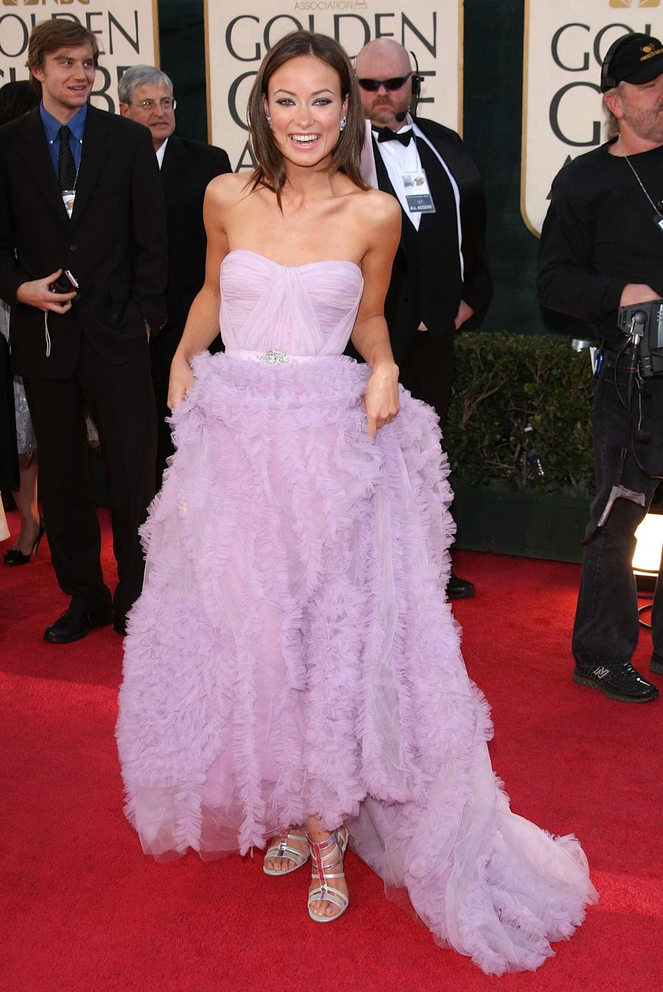 <p>Olivia wore a Reem Acra gown to the 2009 Golden Globe Awards.</p>