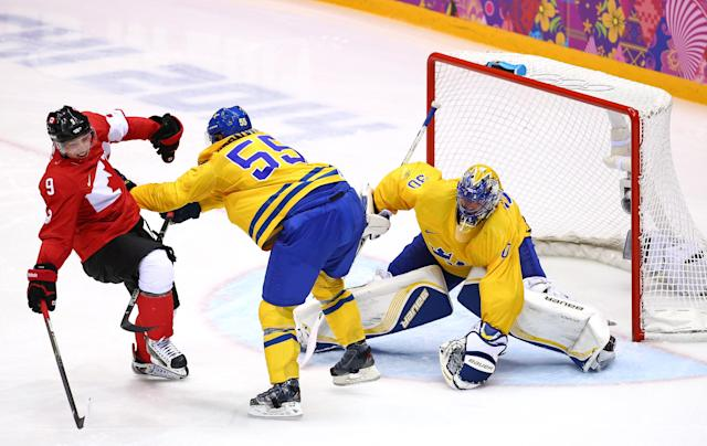 SOCHI, RUSSIA - FEBRUARY 23: Niklas Kronwall #55 of Sweden shoves Matt Duchene #9 of Canada away from the net of Henrik Lundqvist #30 of Sweden during the Men's Ice Hockey Gold Medal match on Day 16 of the 2014 Sochi Winter Olympics at Bolshoy Ice Dome on February 23, 2014 in Sochi, Russia. (Photo by Streeter Lecka/Getty Images)