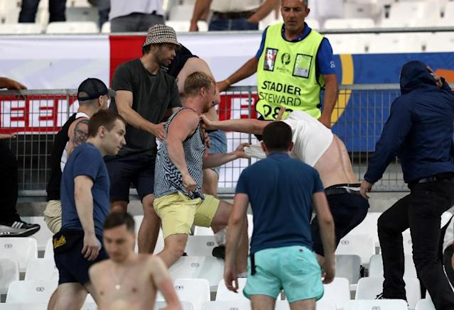 Supporters fight at the end of the Euro 2016 Group B match between England and Russia, at the Stade Velodrome in Marseille on June 11, 2016 (AFP Photo/Valery Hache)