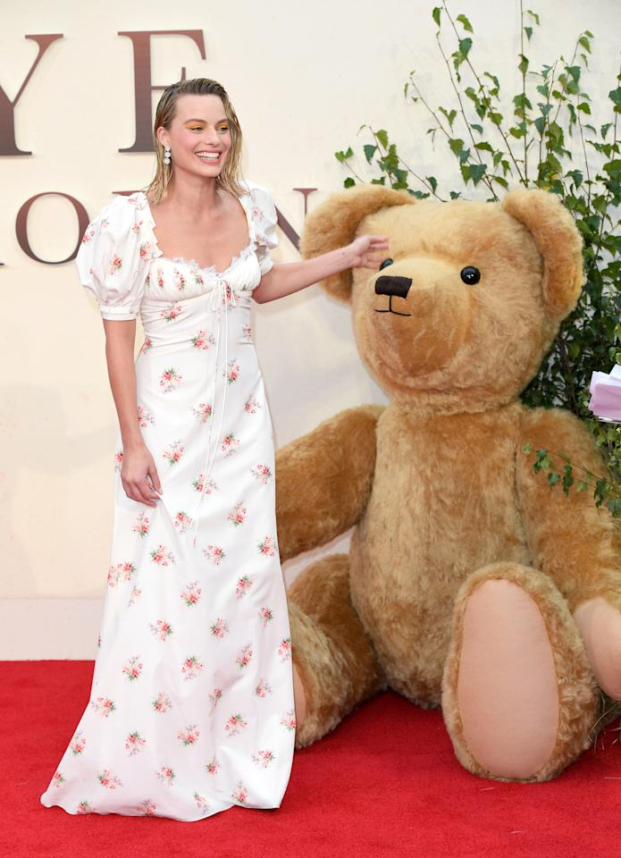 "<p>It's understandable if you can't avert your eyes from the actress long enough to notice the giant teddy bear on the red carpet at the London premiere of <em>Goodbye Christopher Robin</em>. Robbie's wet-hair look and feminine Brock Collection dress <a rel=""nofollow"" href=""https://www.yahoo.com/lifestyle/margot-robbies-offbeat-look-divides-style-critics-154319799.html"">had fans divided</a>. (Photo by Karwai Tang/WireImage) </p>"