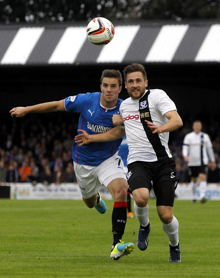 Rangers' Andrew Little (left) and Ayr United's Adam Hunter fight for the ball during the Scottish League One match at Somerset Park, Ayr.