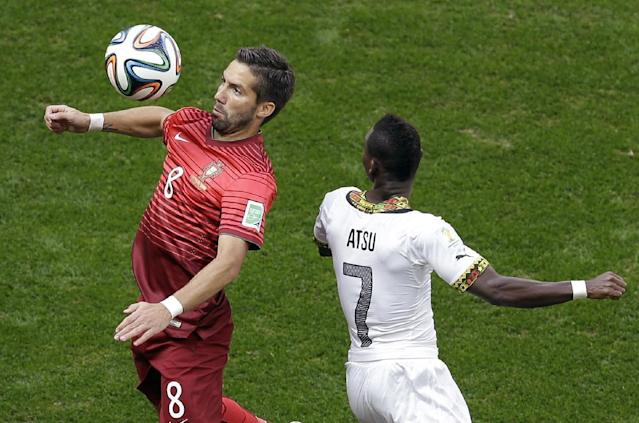 Portugal's Joao Moutinho, left, and Ghana's Christian Atsu challenge for the ball during the group G World Cup soccer match between Portugal and Ghana at the Estadio Nacional in Brasilia, Brazil, Thursday, June 26, 2014. (AP Photo/Themba Hadebe)
