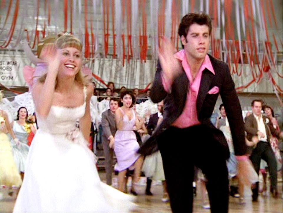 "LOS ANGELES - JUNE 16: The movie ""Grease"", directed by Randal Kleiser. Seen here at high school dance (from left) Olivia Newton-John as Sandy and John Travolta as Danny Zuko. Initial theatrical release of the film, June 16, 1978. Screen capture. Paramount Pictures. (Photo by CBS via Getty Images)"