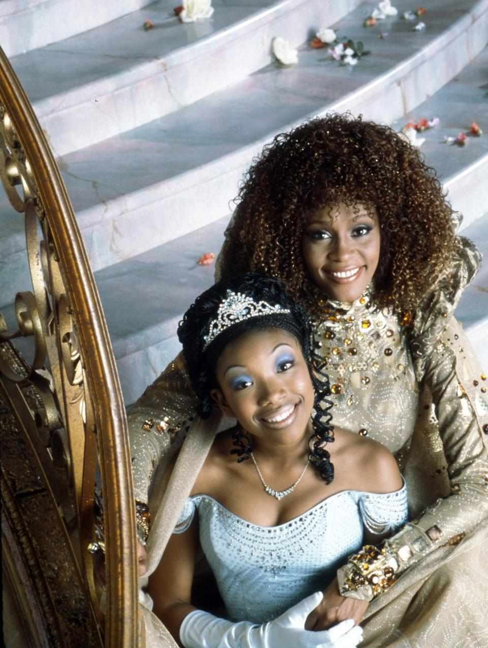 "<p>In the first multiracial cast performance of the classic fairytale, singer-songwriter Brandy plays a Black Cinderella navigating life under the cruelty of her wicked stepmother, played by Bernadette Peters. Released in 1997, the film has a star-studded cast, including the late Whitney Houston and the Grammy-, Emmy-, Academy-, and Tony-Award-winning Whoopi Goldberg.</p> <p><a href=""https://www.amazon.com/Rodgers-Hammersteins-Cinderella-Whitney-Houston/dp/B00004Z4SE/"" class=""link rapid-noclick-resp"" rel=""nofollow noopener"" target=""_blank"" data-ylk=""slk:Watch Cinderella on Amazon"">Watch <strong>Cinderella</strong> on Amazon</a>.</p>"