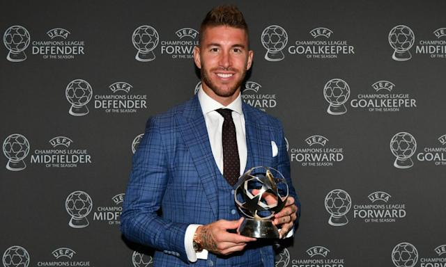 <span>Sergio Ramos with his award as the Champions League defender of the season.</span> <span>Photograph: Harold Cunningham - UEFA/UEFA via Getty Images</span>