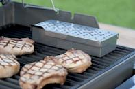 """<p>If Dad has a gas grill but loves the smokiness from charcoal (who doesn't?), this Weber Smoker Box lets him easily infuse that smoky flavor in his cooking.</p><p><a class=""""link rapid-noclick-resp"""" href=""""https://go.redirectingat.com?id=74968X1596630&url=https%3A%2F%2Fwww.walmart.com%2Fip%2FAdd-All-Grilled-Pellet-Shape-Smoke-BBQ-Generator-Smoker-Steel-To-Stainless-Tube-Peralng-Hexagon-6-Perforated-Flavor-Length-304-Foods%2F886747184&sref=https%3A%2F%2Fwww.delish.com%2Fkitchen-tools%2Fcookware-reviews%2Fg4175%2Ffathers-day-grilling-gifts%2F"""" rel=""""nofollow noopener"""" target=""""_blank"""" data-ylk=""""slk:BUY NOW"""">BUY NOW</a> <em><strong>Smoker box, $18.99, walmart.com</strong></em></p>"""