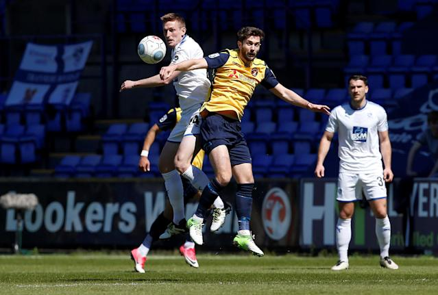 """Soccer Football - National League Play-Off Semi Final - Tranmere Rovers vs Ebbsfleet United - Prenton Park, Birkenhead, Britain - May 5, 2018 Tranmere Rovers' Jeff Hughes (L) in action with Ebbsfleet United's Jack Powell Action Images/Craig Brough EDITORIAL USE ONLY. No use with unauthorized audio, video, data, fixture lists, club/league logos or """"live"""" services. Online in-match use limited to 75 images, no video emulation. No use in betting, games or single club/league/player publications. Please contact your account representative for further details."""