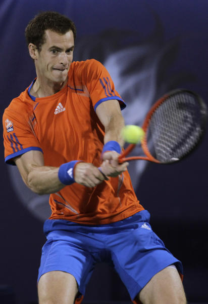 Andy Murray of Britain returns the ball to Roger Federer of Switzerland during their final match at the Emirates Dubai ATP Tennis Championships in Dubai, United Arab Emirates, Saturday, March 3, 2012. (AP Photo/Hassan Ammar)