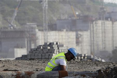 A worker is seen at the construction site of the Panama Canal Expansion project on the outskirts of Colon City