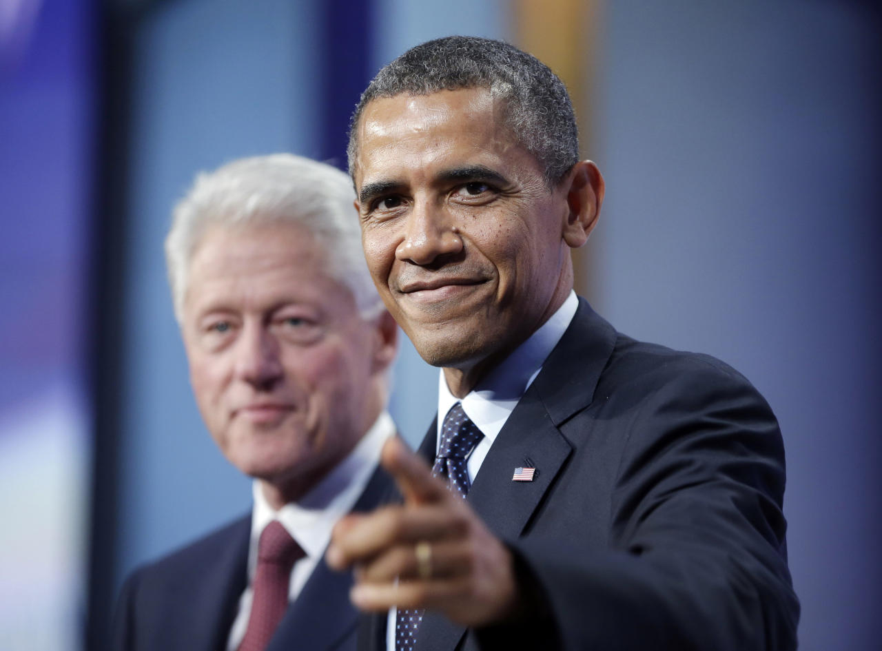President Barack Obama, right, points to members of the audience after speaking at the Clinton Global Initiative with former President Bill Clinton, left, in New York, Tuesday, Sept. 24, 2013. (AP Photo/Pablo Martinez Monsivais)