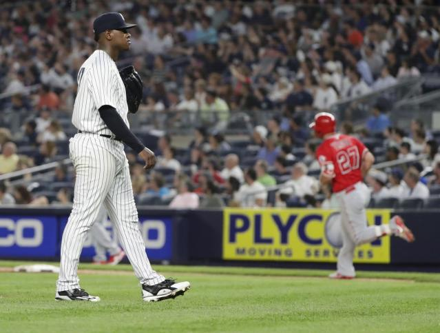 New York Yankees starting pitcher Luis Severino waits as Los Angeles Angels' Mike Trout, right, runs the bases after hitting a home run during the fifth inning of a baseball game Friday, May 25, 2018, in New York. (AP Photo/Frank Franklin II)