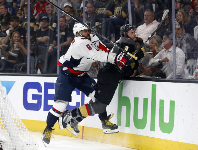Washington Capitals left wing Alex Ovechkin, left, of Russia, puts Vegas Golden Knights defenseman Brayden McNabb into the boards during the first period in Game 2 of the NHL hockey Stanley Cup Finals on Wednesday, May 30, 2018, in Las Vegas. (AP Photo/John Locher)
