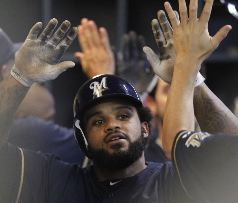 Milwaukee Brewers' Prince Fielder gets high-fives in the dugout after hitting a two-run home run against the New York Mets in the fourth inning of a baseball game, Wednesday, June 8, 2011, in Milwaukee.  (AP Photo/Jeffrey Phelps)