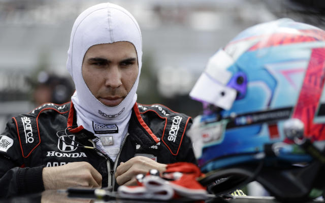 """FILE - In this Aug. 18, 2018, file photo, Robert Wickens prepares to qualify for an IndyCar series auto race in Long Pond, Pa. Wickens is paralyzed from the waist down from injuries suffered in an August crash at Pocono Raceway. Wickens has been updating his rehabilitation progress on social media and posted a video Thursday of his """"first slide transfer as a paraplegic"""" that showed him moving from a table to his wheelchair. His videos had shown for the past month that he is working daily to move his legs again, but his Thursday, Oct. 25, 2018, post was the first time he publicly confirmed paralysis. (AP Photo/Matt Slocum, File)"""