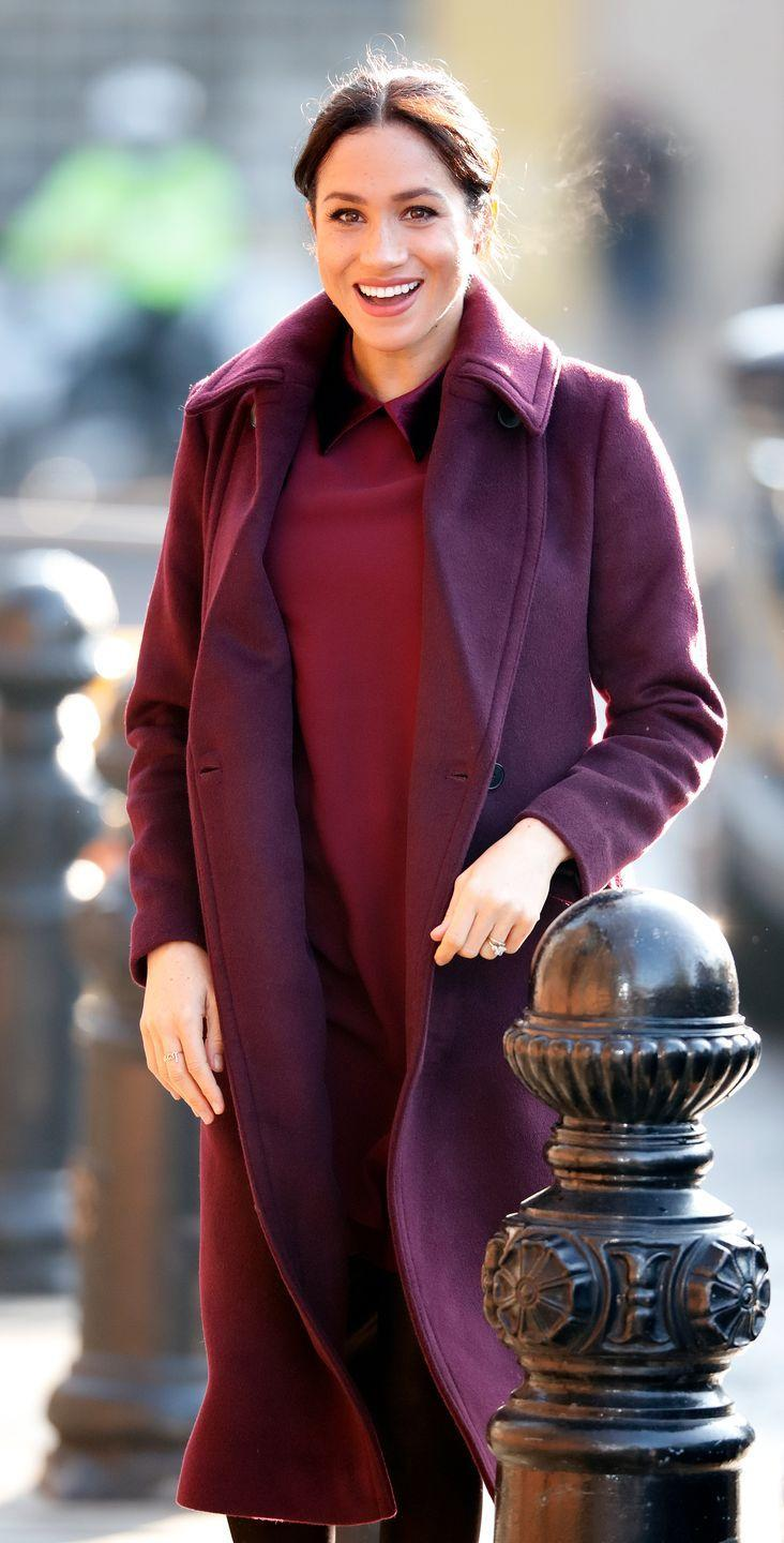 <p>Meghan was spotted in a similar burgundy coat and dress while visiting the Hubb Community Kitchen in 2018. Such a nice color on her. </p>
