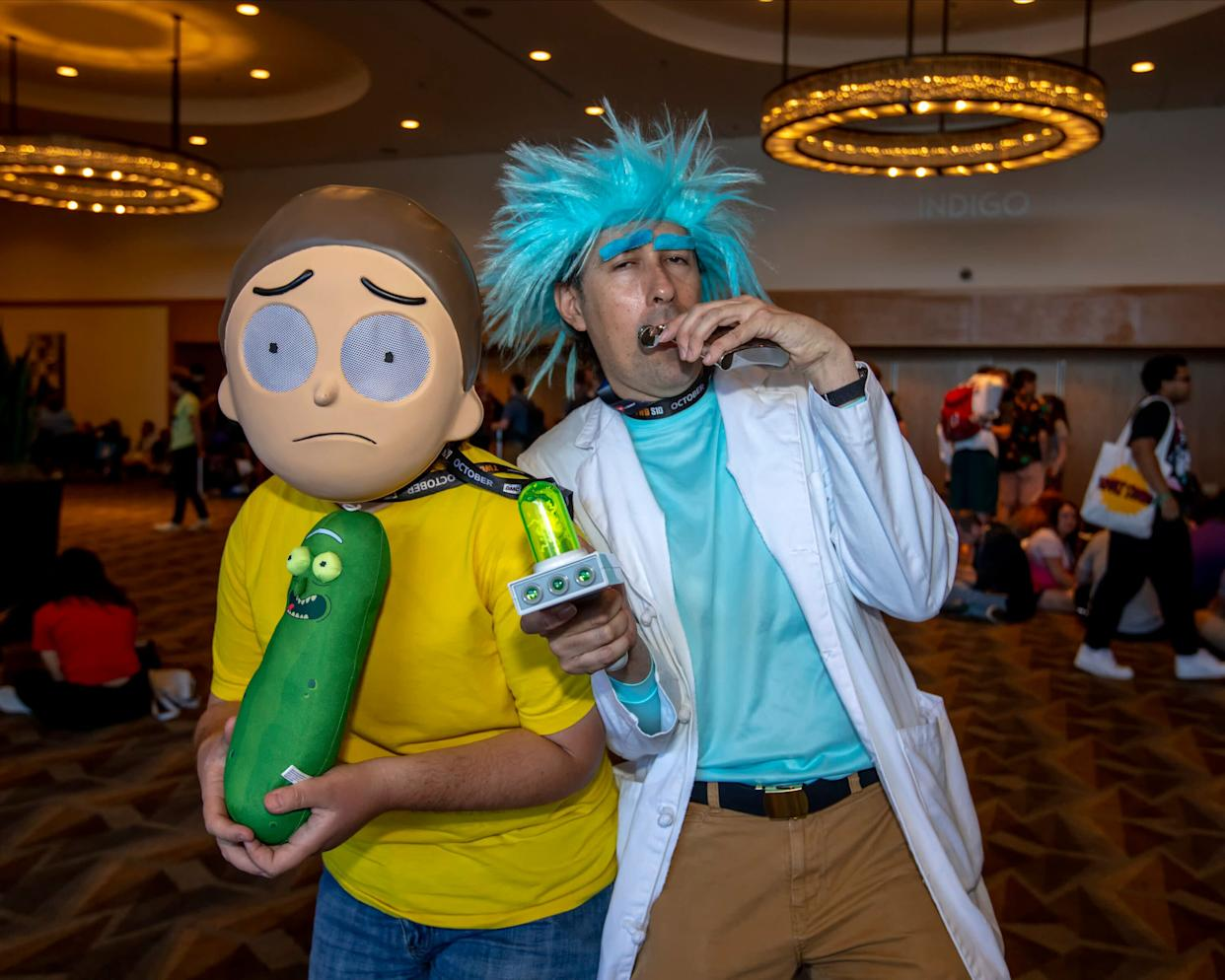 """Matt Kaster, of Phoenix, dressed as """"Morty Smith"""" and Robert Enright, of San Diego, Calif., dressed as """"Rick Sanchez."""""""