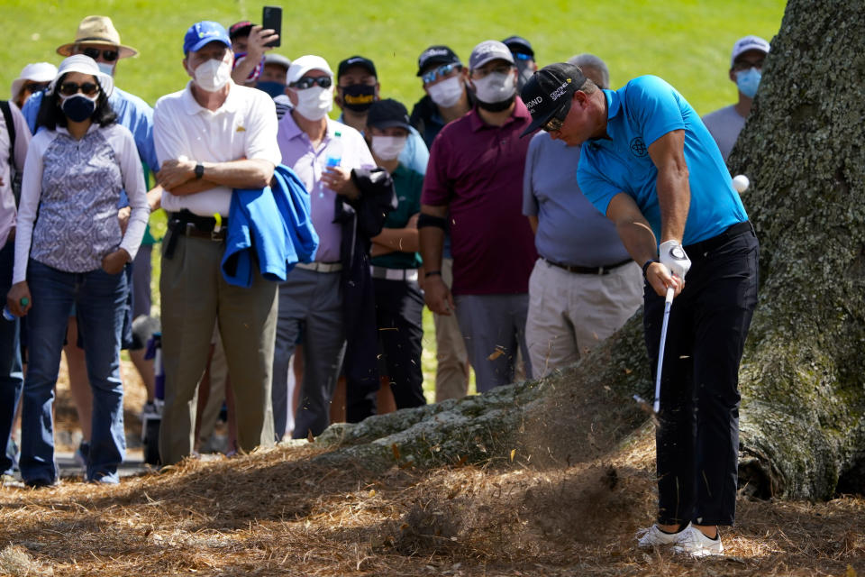 Brian Gay hits from the pine straw on the 18th hole during the first round of the The Players Championship golf tournament Thursday, March 11, 2021, in Ponte Vedra Beach, Fla. (AP Photo/John Raoux)