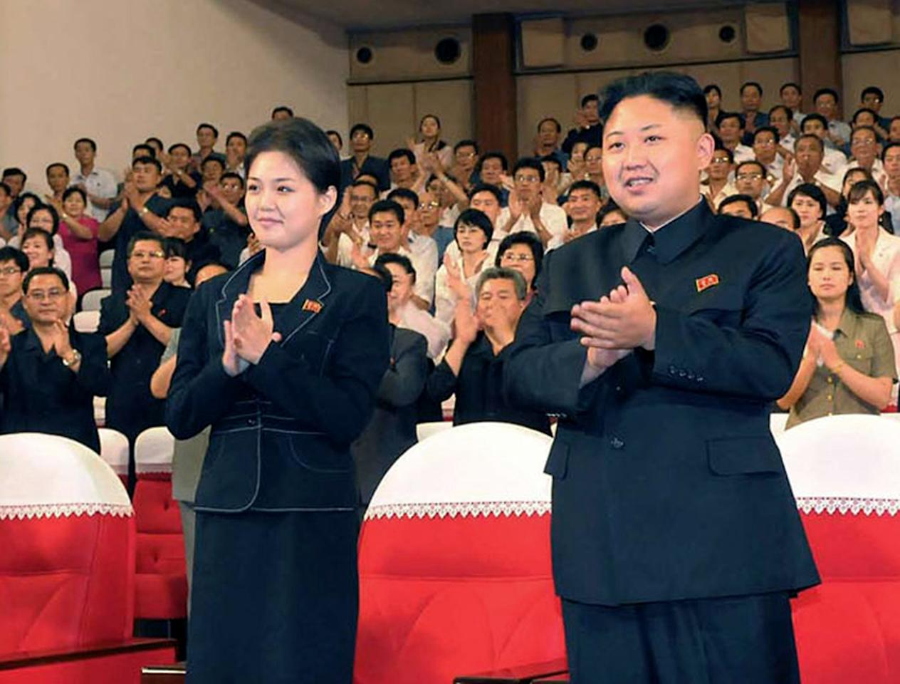"FILE - This is a file photo made available on Monday July 9, 2012 by the Korean Central News Agency (KCNA) and distributed in Tokyo by the Korea News Service of North Korean leader Kim Jong Un, right, and Ri Sol Ju as they clap with others during a performance by North Korea's new Moranbong band in Pyongyang, North Korea earlier in July. North Korea's new, young leader Kim Jong Un is married, state TV reported Wednesday July 25, 2012 for the first time in a brief and otherwise routine announcement that ends weeks of speculation about a beautiful woman who has accompanied him to recent public events. Kim toured an amusement park with his ""wife, comrade Ri Sol Ju"" on Tuesday, while a crowd cheered for the leader, the news anchor said without giving any more details about Ri, including how long they had been married. (AP Photo/Korean Central News Agency via Korea News Service, File)"