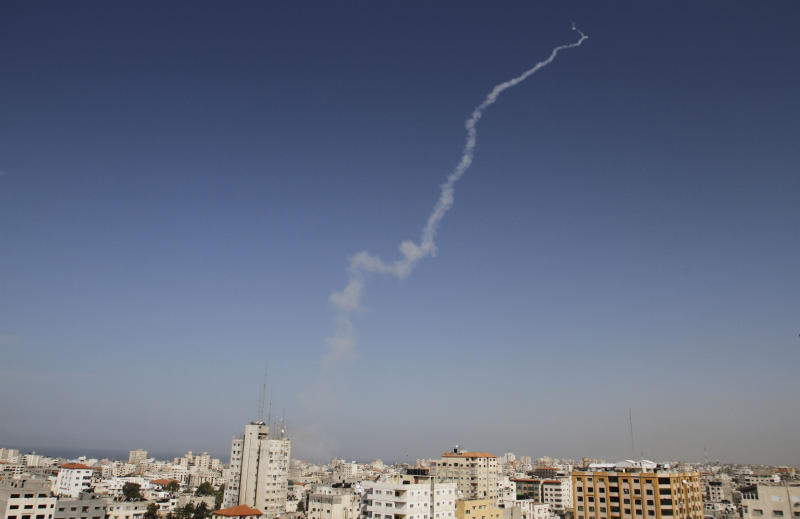 Smoke trails are seen after a missiles was fired by Palestinian militants from Gaza City towards southern Israel, Sunday, Nov. 18, 2012. Israel continues to hold off on a ground campaign into the Gaza Strip even as it widens the scope of airstrikes. Israeli military aircraft attacked two buildings used by both Hamas and foreign media outlets on Sunday. (AP Photo/Hatem Moussa)