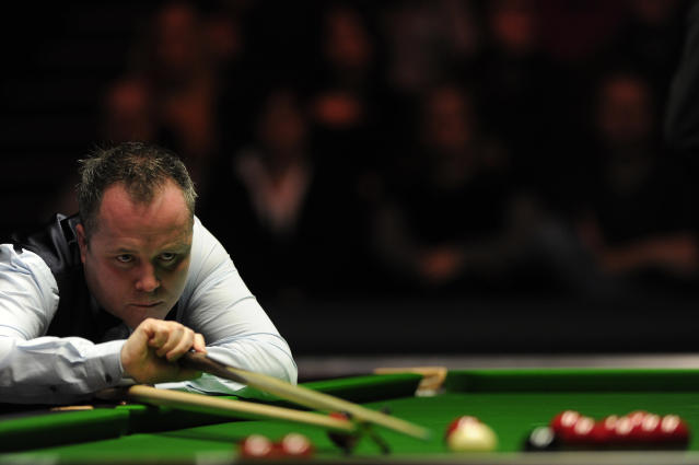 John Higgins of Scotland plays a shot against Shaun Murphy of England during the semi-final match in the BGC Masters snooker tournament at Alexandra Palace in north London on January 21, 2012. AFP PHOTO / CARL COURT (Photo credit should read CARL COURT/AFP/Getty Images)