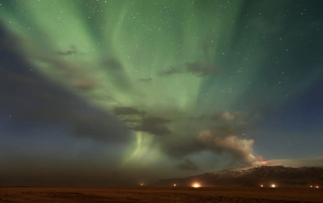 Highly Commended (Earth and Space) 'Volcanic Aurora' by Örvar Atli Þorgeirsson (Iceland) A shimmering aurora, resulting from magnetic activity on the Sun, provides a spectacular background to a dramatic eruption of the Eyjafjallajökull volcano. A dark cloud of ash at ground level can be seen to the left in this photograph, while there is bright red lava at the mouth of the volcano. The eruption caused substantial disruption to international travel in the spring of 2010.