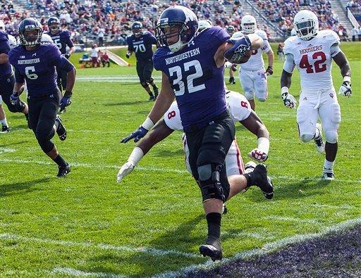 Northwestern's Mike Trumpy steps out of bound son a run against Indiana during the second quarter of an NCAA college football game in Evanston, Ill. on Saturday, Sept. 29, 2012. (AP Photo/Charles Cherney)
